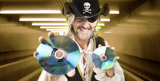 pirate holding CD and DVD