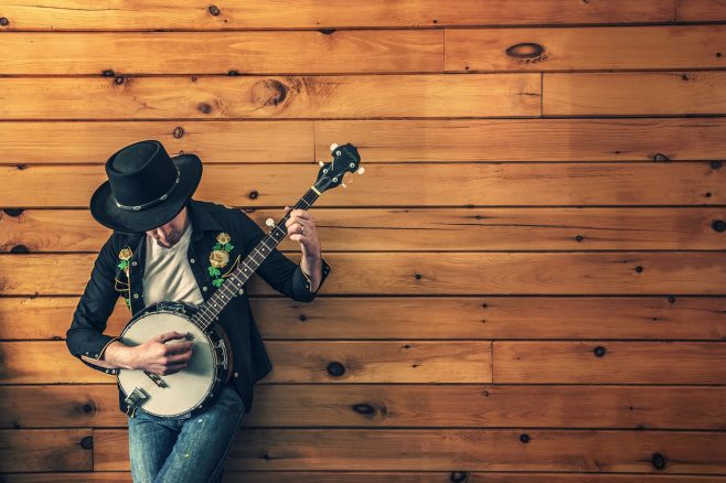 musician with round guitar