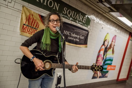 musician busking on subway